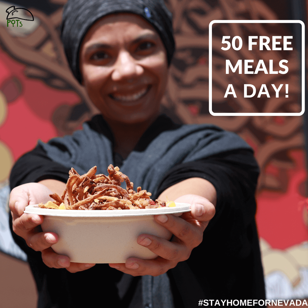 50 Free meals a day - chef Iman holding the Koshari