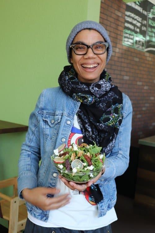 Chef Iman holding Arugula salad