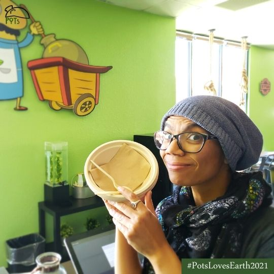 Iman holding earth-friendly serving dishes used at POTs